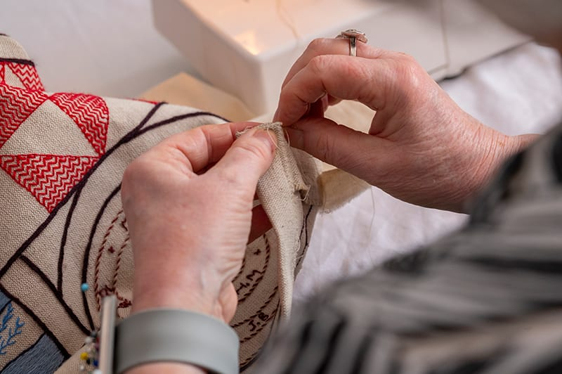 Dorie Wilkie preparing the Great Tapestry of Scotland